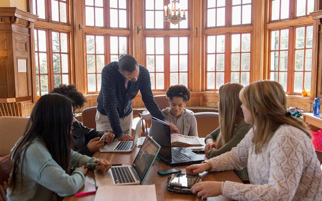 College students using laptops and other technology