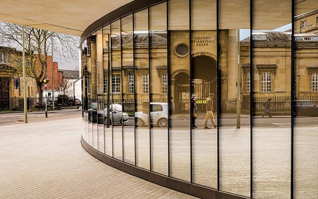 Oxford University Press buildings reflected in the Blavatnik School