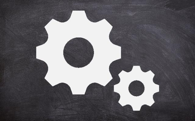Icon of cogs, on a background of a blackboard
