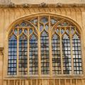 University buildings reflected in mullion windows