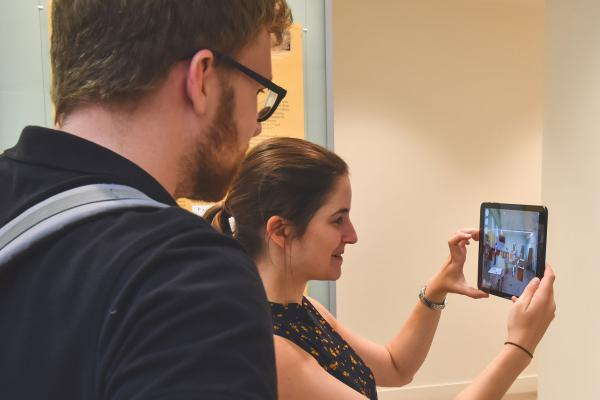 Two students using an Augmented Reality (AR) application on a tablet