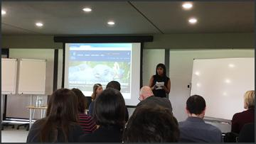 Female lecturer giving presentation at Oxford Digital Teaching Innovation Forum meeting